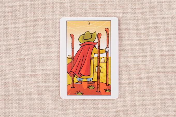 3本の棒と青年のカード
