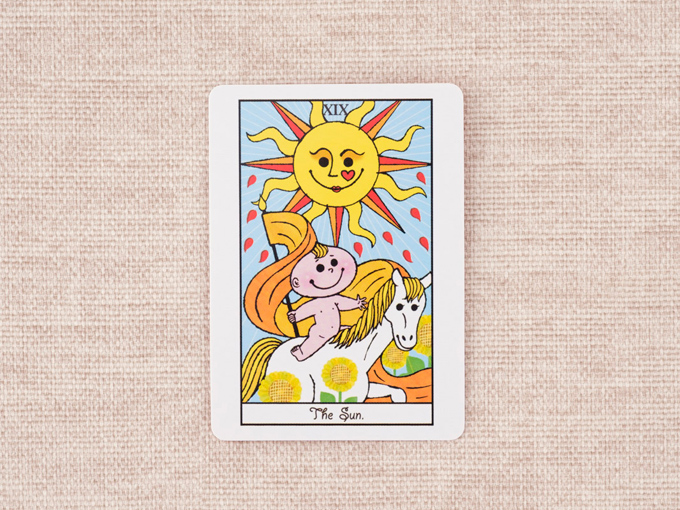 太陽と裸の子どもの絵