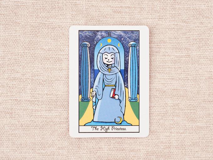 水色のローブを着た女性の絵
