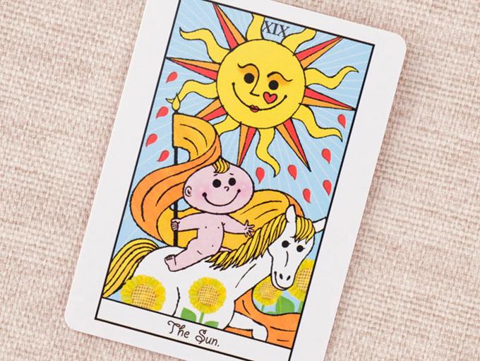 太陽と馬に乗った男の子の絵