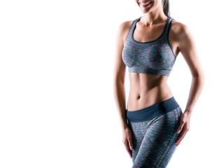 トレーニングウェアを着てお腹を出している女性の画像
