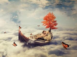 雲の上で寝ている女性