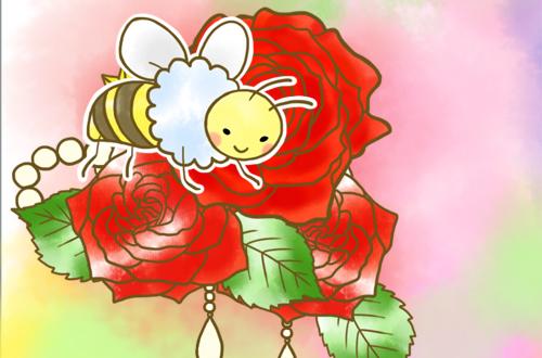 左の赤いバラにとまってるはち