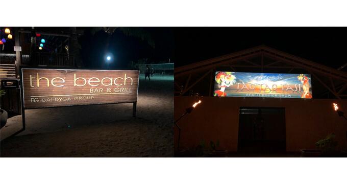 左 「THE BEACH」の看板 右 タオタオ タシの看板