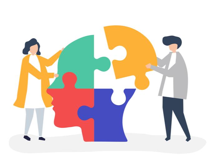 頭のジグソーパズルのピースをつなぐ人々の様子を表したメンタルヘルスのシンボル的イラスト