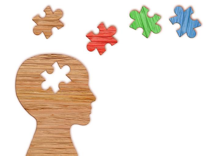 カットパズルと人間の頭のシルエットでメンタルヘルスを表すイラスト