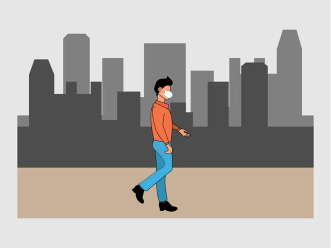 マスクをして街を歩く男性のイラスト