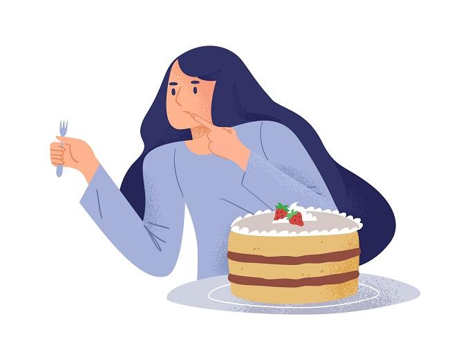 ケーキを食べようとする女性