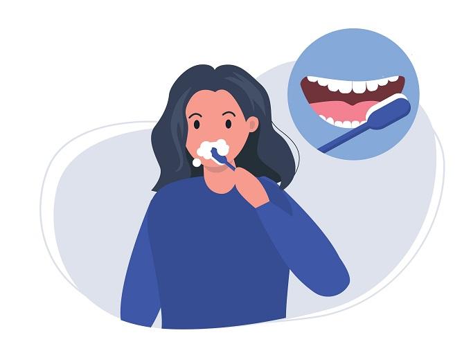 歯みがきをしている女性のイラスト