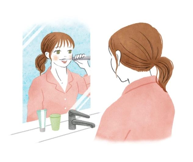 洗面所で歯磨きをする女性のイラスト