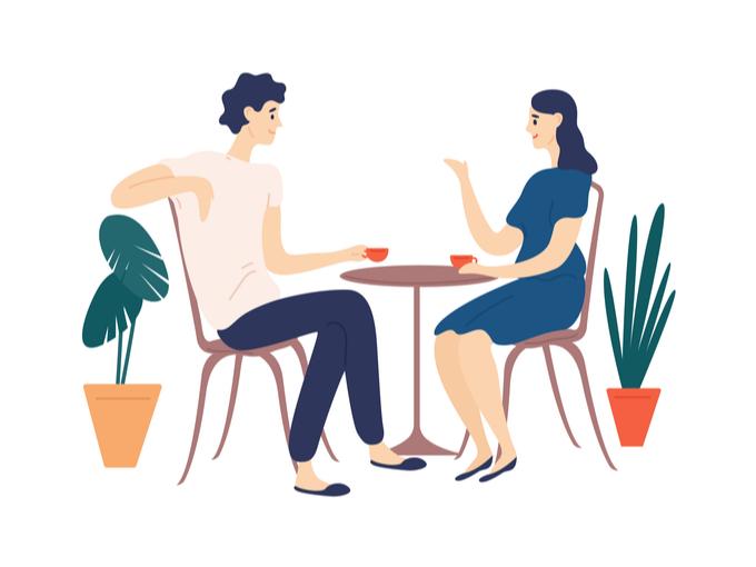 話し合っているカップルの画像