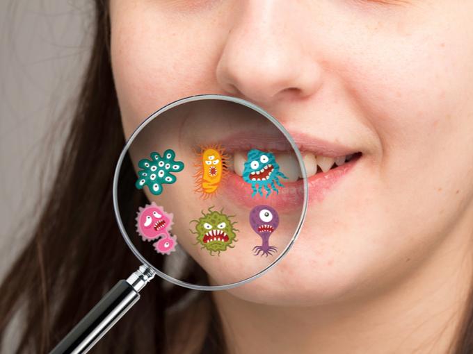女性の口もとと、微生物のイラスト
