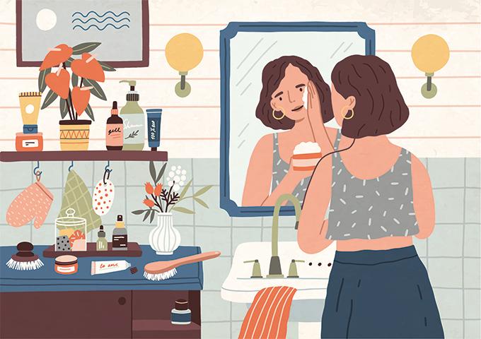 鏡の前でスキンケアする女性