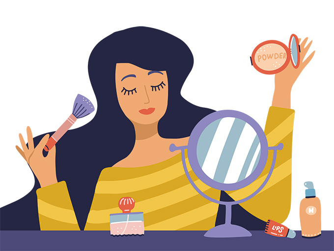 鏡の前でメイクする女性