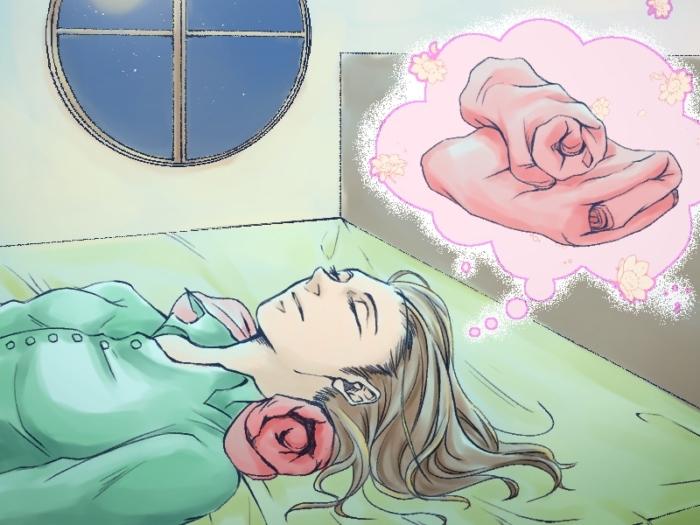 タオル枕に寝ている女性