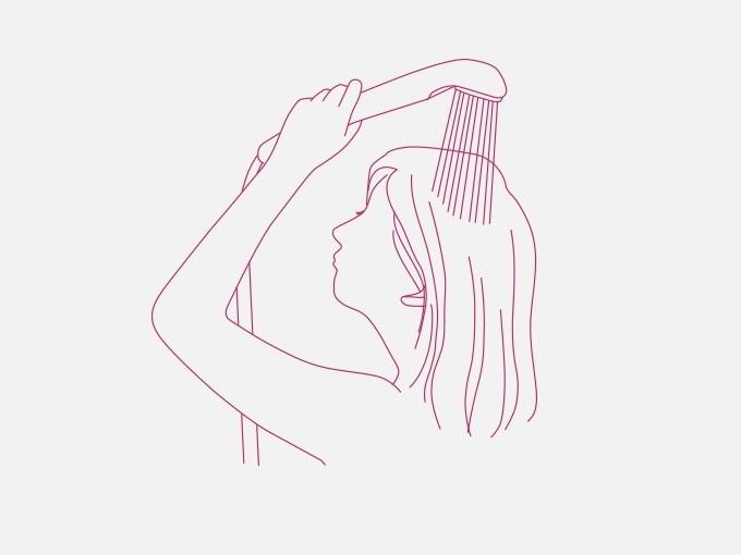 髪をシャワーですすいでいる女性のイラスト